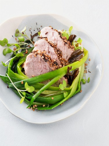 Roasted pork marinated in tea with sesame seeds and spring onions