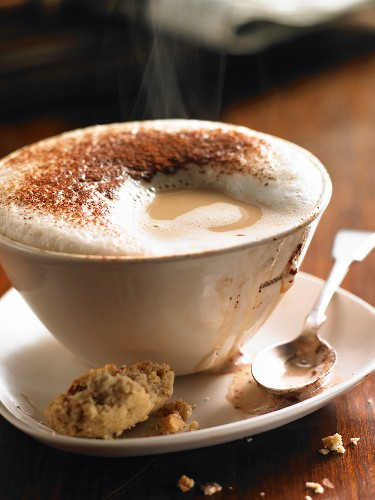 A steaming cappuccino with milk foam