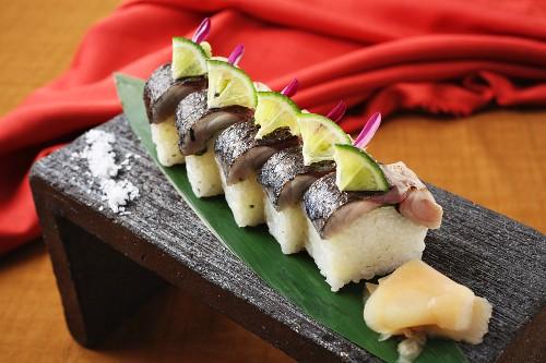 Oshi sushi on a wooden board (Japan)