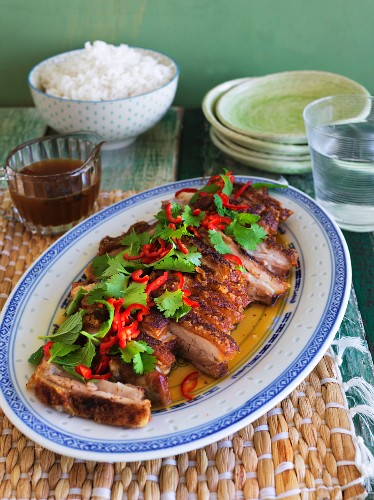 Spicy pork belly with chilli Peppers and coriander and a side of rice (China)