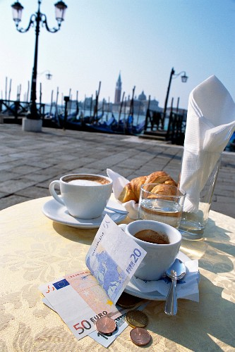 Coffee, pastries and money at a pavement cafe in Venice, Italy