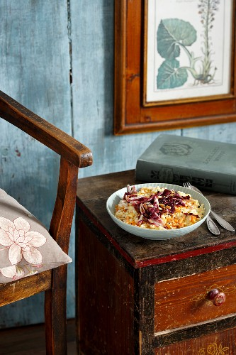 Carrot risotto with radicchio on an old wooden sideboard