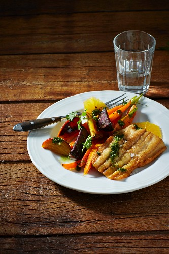 Sheatfish fillet with beetroot, yellow beets, carrots, herbs, oranges and pesto