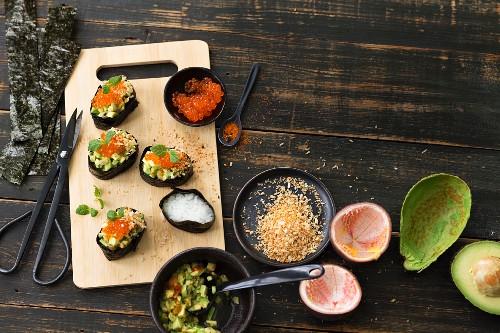 Gunkan sushi with avocado and caviar