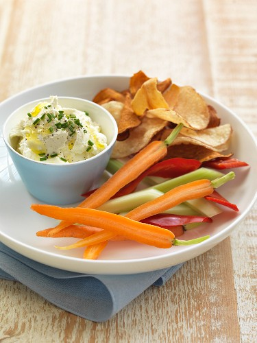 A goat's cream cheese and chive dip, raw vegetables and adjustable crisps