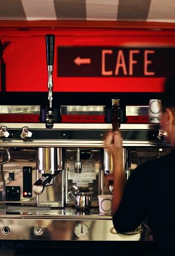 A mobile espresso bar: a person operating the espresso machine