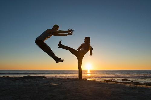 People practising sport on the beach at La Jolla, California