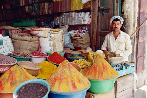 A man selling spices in his shop at Saidu Sharif, Swat, Pakistan, Asia