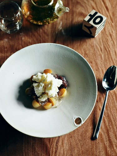Shaved milk ice with poached pear and ginger jelly
