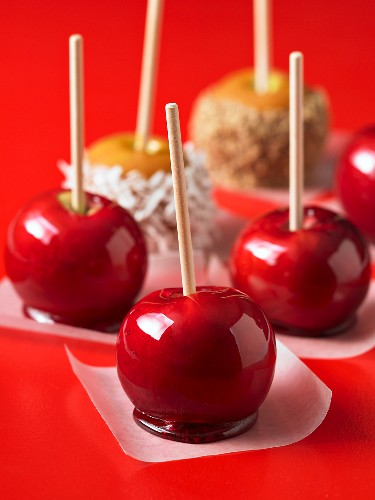Toffee apples on pieces of paper