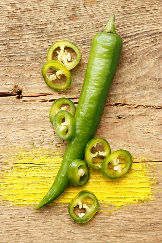 Green chilli peppers, whole and sliced