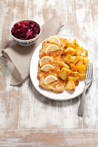 Turkey escalope, baked potatoes and beetroot salad