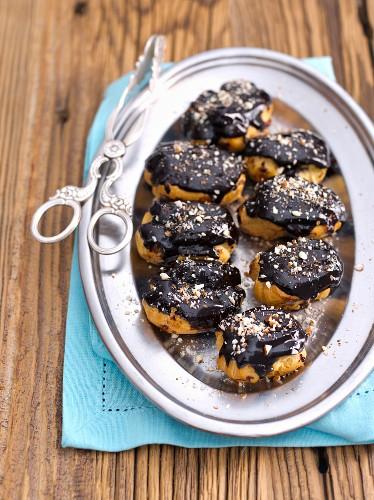 Mini eclairs with chocolate glaze