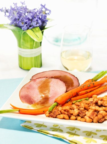 Roast ham with gravy and carrots for Easter