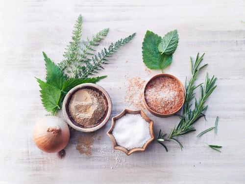 An arrangement of medicinal clay, salt, herbs and onions