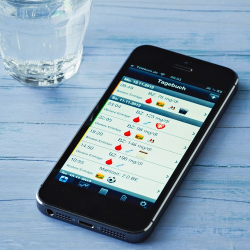 A mobile phone displaying a diabetes app