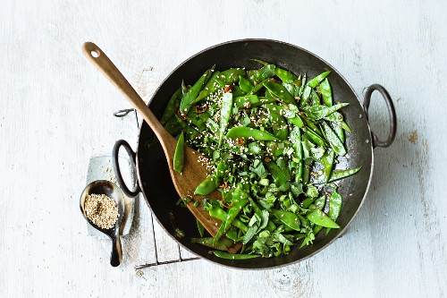 Stir-fried sesame seed mange tout with ginger, chilli and spring onions