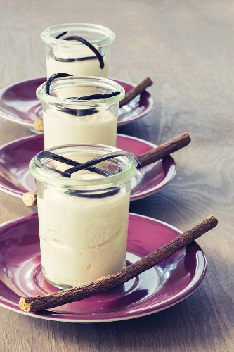 Liquorice mousse in glasses garnished with liquorice laces and sticks
