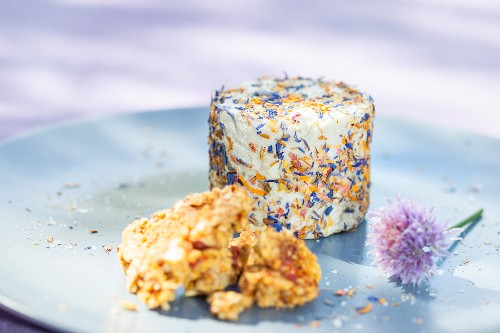 Cream cheese made from sauerkraut juice and macadamia nuts wrapped in flowers