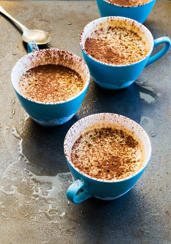 Frozen sabayon with cocoa powder in blue cups