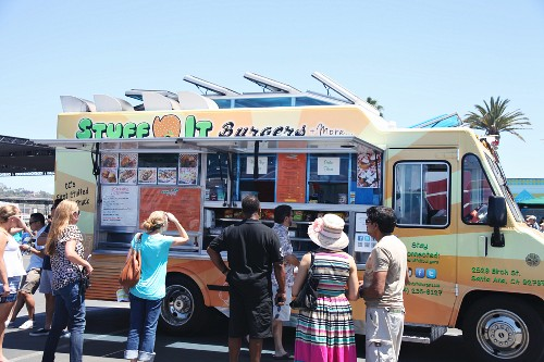 Customers in front of a food truck at a food truck festival in California, USA