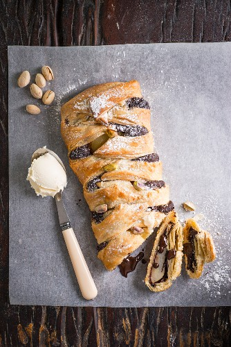 A plaited pear and chocolate tart with nuts and vanilla ice cream