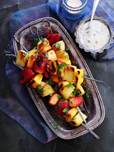 Fruit skewers with a passion fruit dip