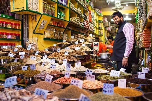 A street vendor in his spice shop in Delhi, India