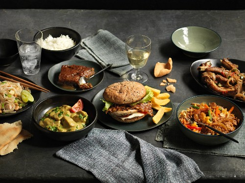 An arrangement of various oriental and American dishes