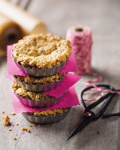 A stack of crunchy tartlets in baking tins