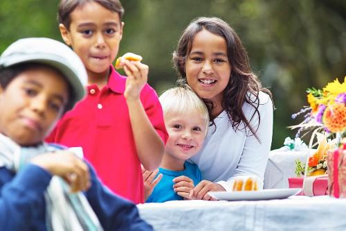 Four children at a garden party