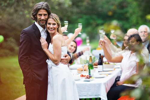 A bride and groom at a garden party