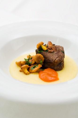 Stuffed saddle of venison with mushrooms, polenta and pepper cream