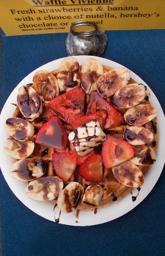 Waffles with strawberries, bananas and chocolate sauce (Mexican street food in Los Angeles, USA)