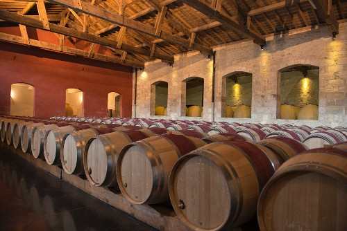 Wooden barrels and amphorae in the cellar at Chateau Pontet-Canet (Bordeaux, France)