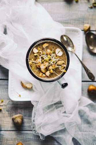 Chestnut mushroom soup with hazelnuts (seen from above)