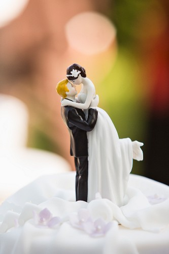 A porcelain bride and groom on a wedding cake