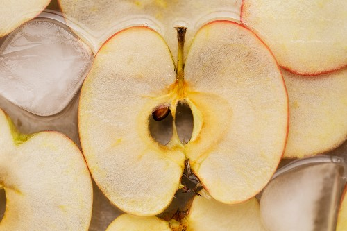 Slices of apple in iced water (seen from above)