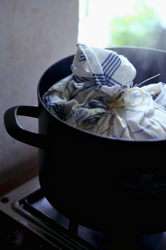 A yeast dumpling being cooked in a cloth