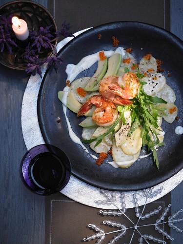 Avocado and potato carpaccio with prawns, rocket, a lime dressing and trout caviar for Christmas