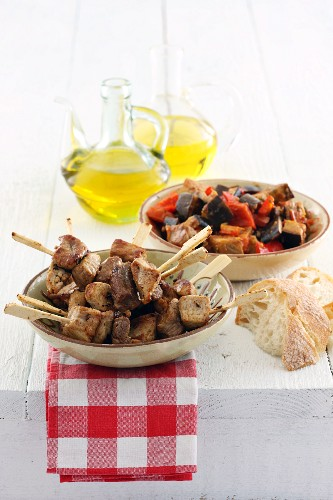 Pork skewers with Mediterranean vegetables