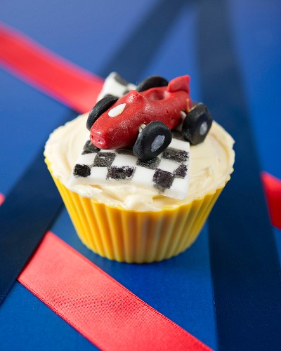 A racing car cupcake with a checked flag