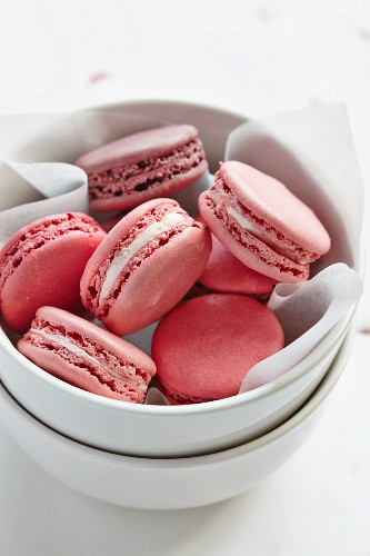 Pink macaroons in a porcelain bowl