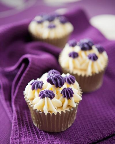 Vanilla cupcakes with violet cream