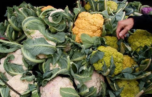 Different coloured cauliflower at a market