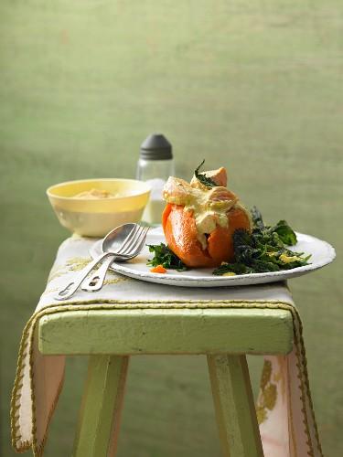 Stuffed sweet potato with diced lemon salmon and fried stinging nettles