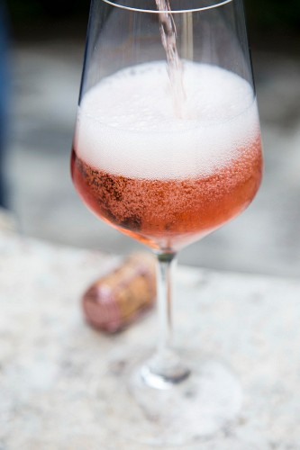 Prosecco rose being poured into a glass