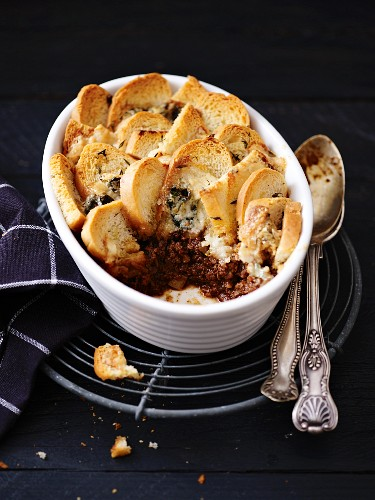 Game bolognese bake with white bread and blue cheese