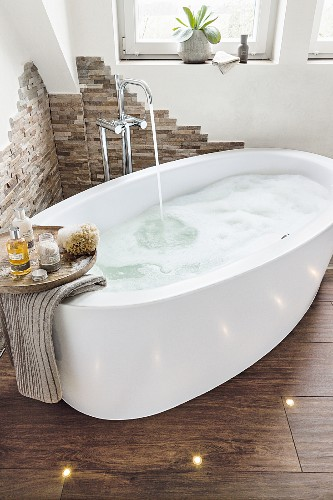 An oval bathtub filled with bubbles in a … – Buy image – 11396864 ...