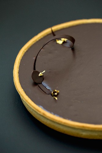 Chocolate tart with gold leaf (detail)
